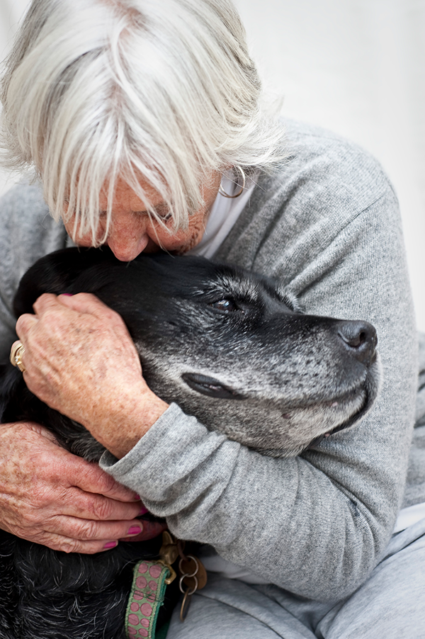 woman-hugging-senior-dog